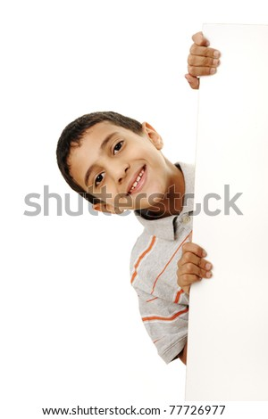 Portrait of a happy little boy holding a blank board against white background - stock photo
