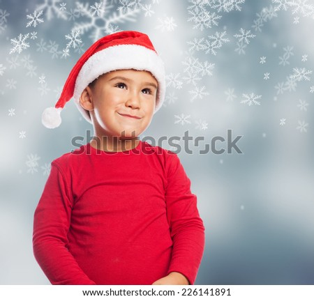 portrait of a happy little boy waiting for christmas eve