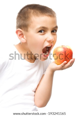Portrait of a happy little boy with red apples, isolated over white - stock photo