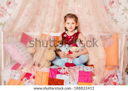 portrait of a happy little girl in fairy costume
