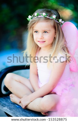 portrait of a happy little girl in fairy costume outdoor - stock photo