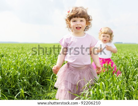 Portrait of a happy little girl outdoors in summer - stock photo