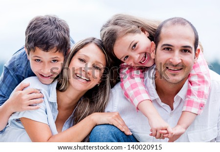 Portrait of a happy loving family smiling outdoors - stock photo
