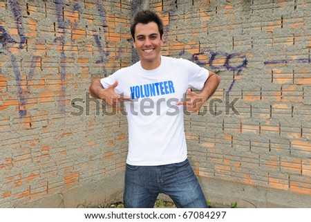 portrait of a happy male volunteer - stock photo