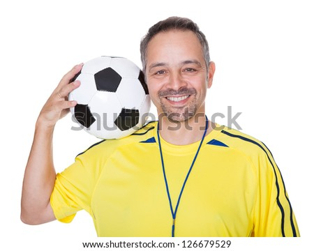 Portrait Of A Happy Man Holding A Soccer Ball On Shoulder Isolated On White Background