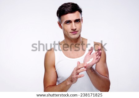 Portrait of a happy man with cream on the hand - stock photo