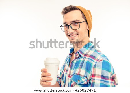 Portrait of a happy man with glasses cocktail and hat - stock photo