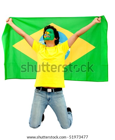 Portrait of a happy man with the brazilian flag painted on his face isolated over white - stock photo
