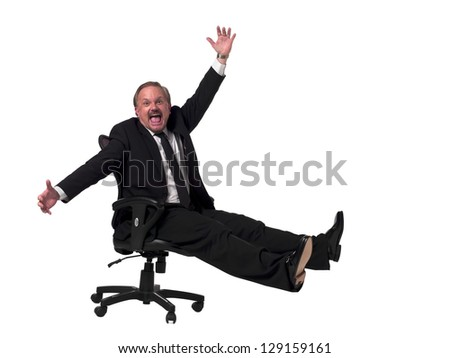 Portrait of a happy mature businessman gesturing while sitting on a chair over white background
