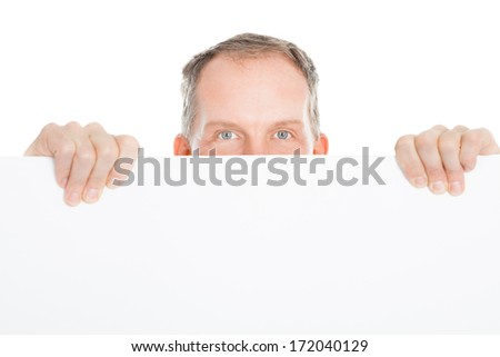 Portrait Of A Happy Mature Man Holding Placard Over White Background - stock photo