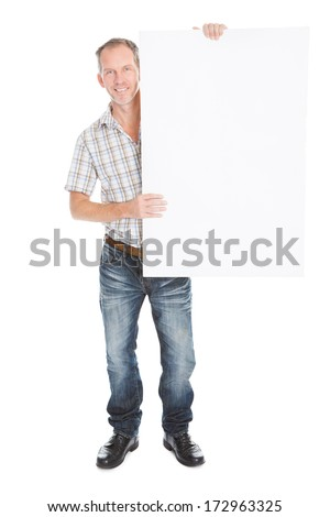 Portrait Of A Happy Mature Man Holding Placard Over White Background