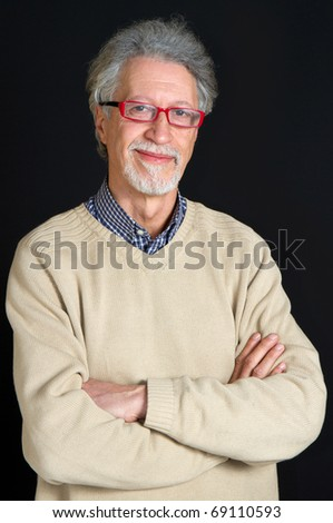 Portrait of a happy mature man isolated on black background - stock photo