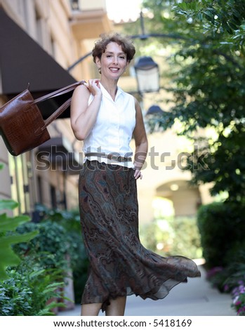 Portrait of a happy mature woman in motion - stock photo