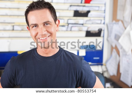 Portrait of a happy mechanic looking at the camera - stock photo
