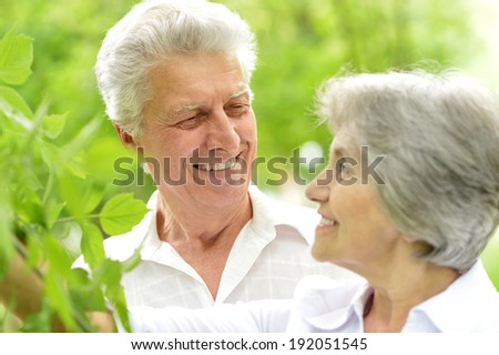 Portrait of a happy middle-aged couple on a walk in the late spring
