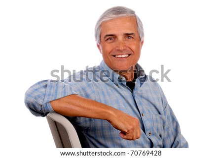 Portrait of a Happy Middle Aged Man sitting with his arm resting on chair back on a white background.