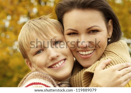 portrait of a happy mom and her nice son