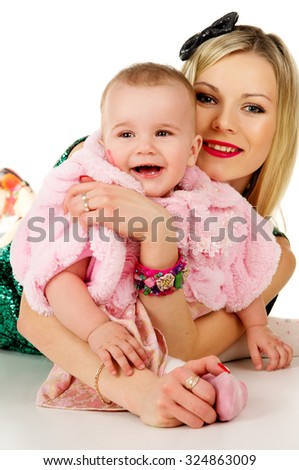 portrait of a happy mother and baby isolated - stock photo