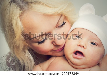 Portrait of a happy mother and cute baby