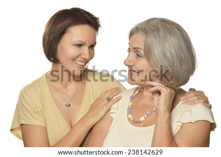 Portrait of a happy mother and daughter on white - stock photo