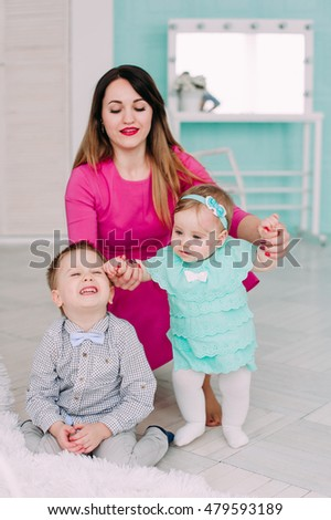 Portrait of a happy mother and her children in studio