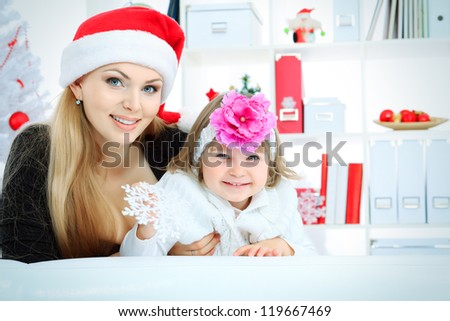 Portrait of a happy mother with her daughter at home. - stock photo