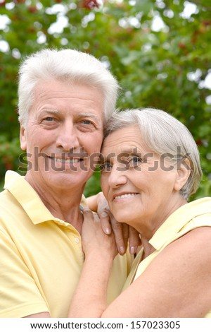 Portrait of a happy old couple in the late spring outside