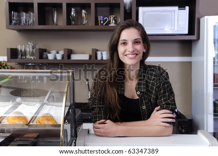 portrait of a happy owner of a cafe or waitress - stock photo