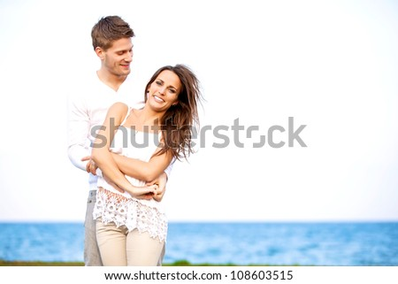 Portrait of a happy playful couple having fun outdoors - stock photo