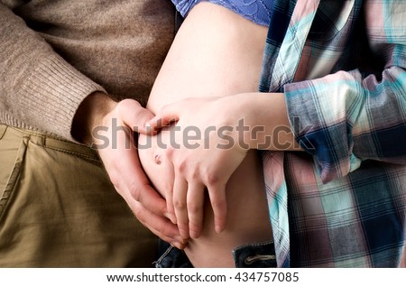 Portrait of a happy pregnant couple - stock photo