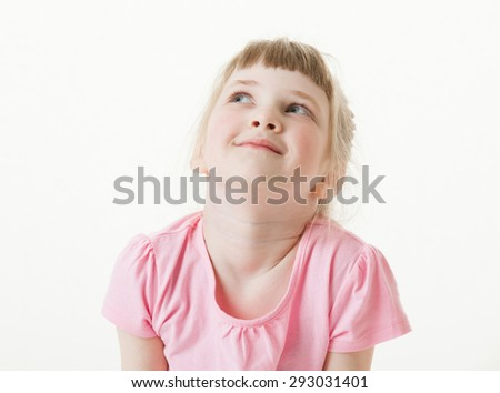 Portrait of a happy  pretty little girl looking up on white background - stock photo