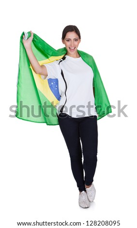 Portrait Of A Happy Pretty Woman Holding An English Flag. Isolated On White - stock photo