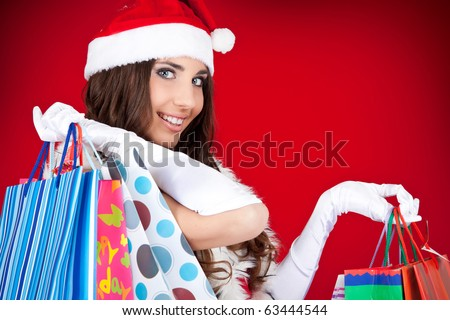 portrait of a happy santa woman with shopping bags - stock photo