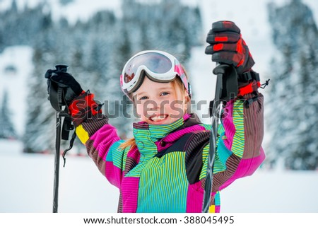 Portrait of a happy school girl at the ski slope