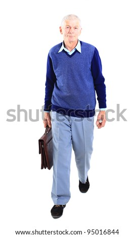 Portrait of a happy senior carrying a suitcase on white background - stock photo