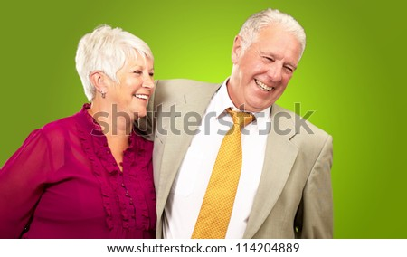 Portrait Of A Happy Senior Couple Isolated On Green Background - stock photo