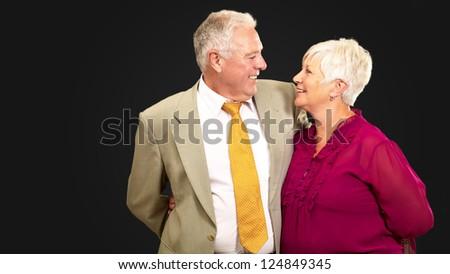 Portrait Of A Happy Senior Couple On Black Background - stock photo