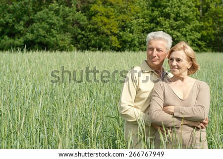 Portrait of a happy senior couple relaxing - stock photo