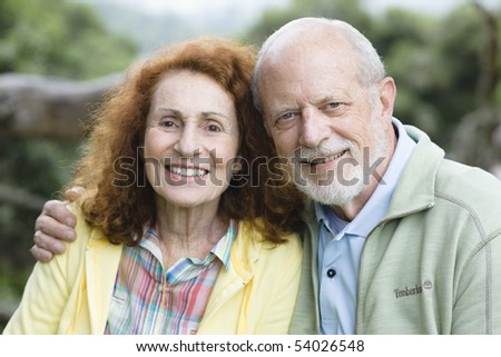Portrait of a Happy Senior Couple Smiling Outdoors in a Park - stock photo