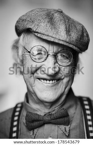 Portrait of a happy senior man looking at camera - stock photo