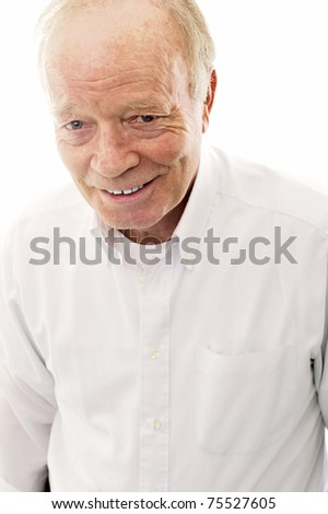 Portrait of a happy senior man smiling over bright background