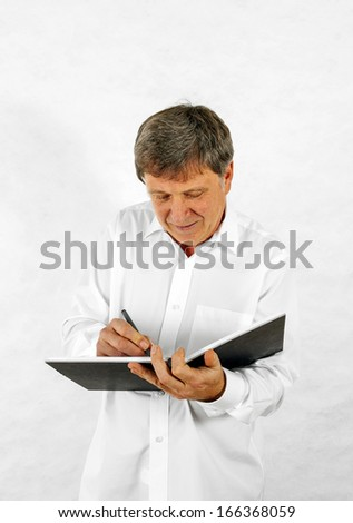 Portrait of a happy senior man standing gesturing against white background