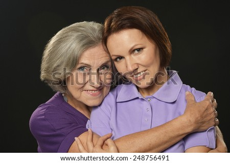 Portrait of a happy senior mother and daughter - stock photo
