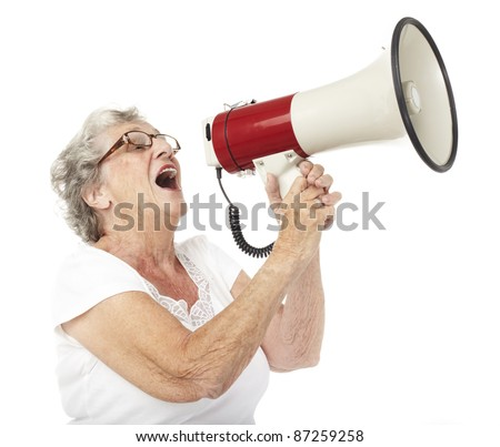 portrait of a happy senior woman shouting with megaphone over white background - stock photo