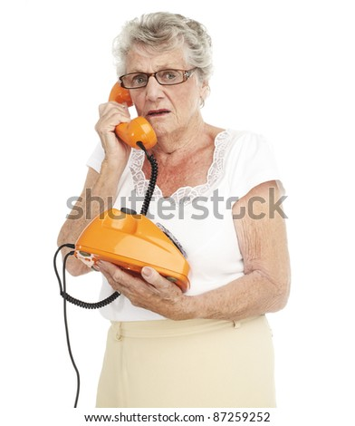 portrait of a happy senior woman talking on telephone over white background - stock photo