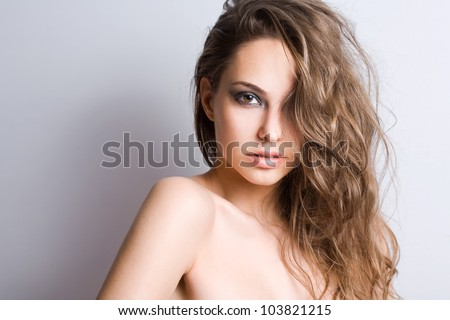 Portrait of a happy sensual young brunette beauty. - stock photo