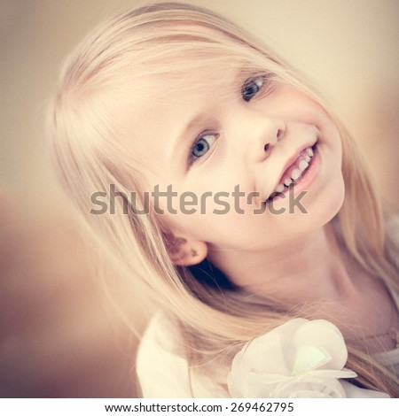 Portrait of a happy smiling adorable preschool age girl - stock photo