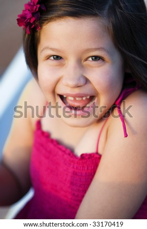 Portrait of a happy smiling excited little girl