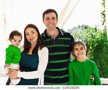 Portrait of a happy smiling family outdoors