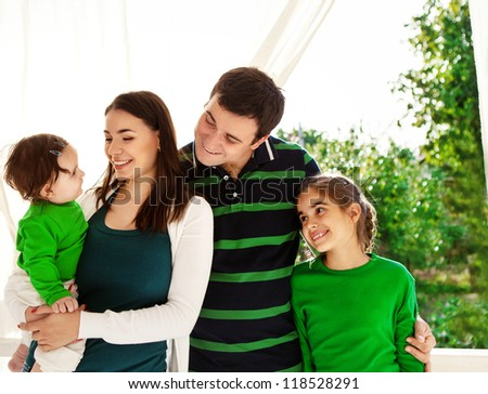 Portrait of a happy smiling family outdoors - stock photo
